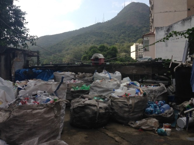 Recycling piles at the Tá Limpo warehouse, sorted into bags to later be compacted and sold per kilo