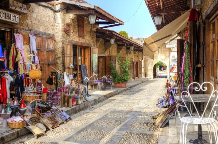 A view of the old pedestrian souk in Byblos, Lebanon during the day. A very medieval and picturesque area,  paved with little stones and with little shops.